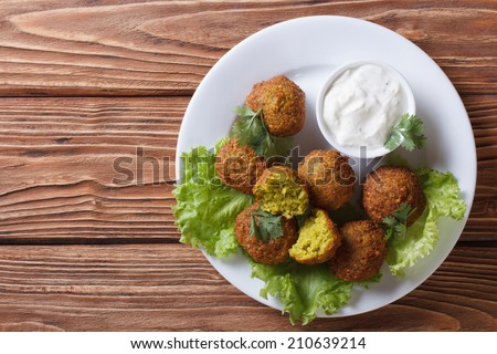 delicious falafel on lettuce with tzatziki sauce close-up view from above horizontal   - stock photo