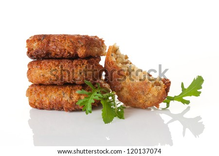 Delicious falafel patty pile with fresh herbs isolated on white background. Culinary arab vegan eating.