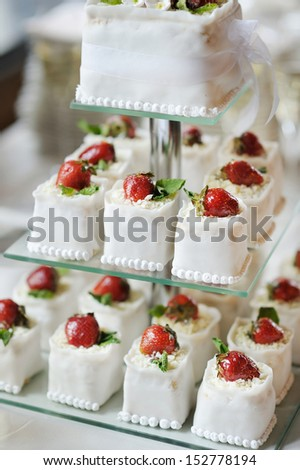 Delicious fancy wedding cake made of strawberry cupcakes