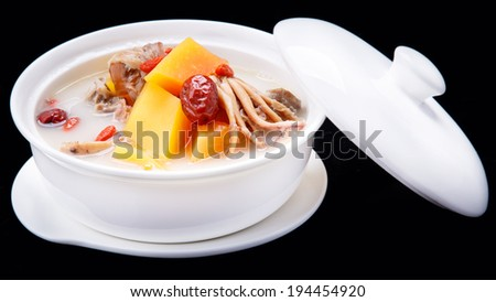 delicious fish soup in casserole, Chinese traditional cuisine isolated on black background