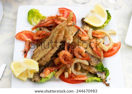 Delicious fish with shrimp and squid fried.