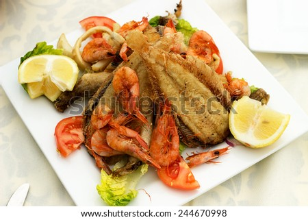 Delicious fish with shrimp and squid fried. - stock photo