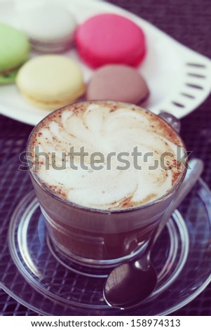 delicious flavored cappuccino and French macaroon