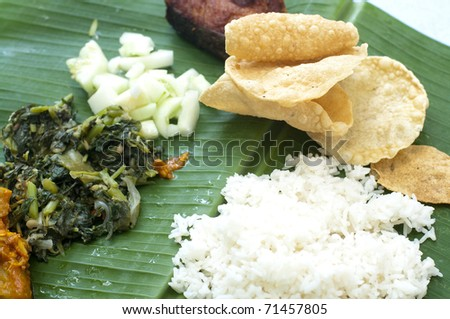 Delicious food - Indian cuisine banana leaf rice - stock photo