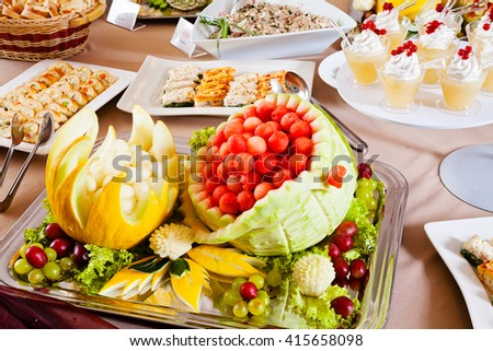 Delicious food on buffet table - stock photo