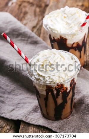 Delicious frappe coffee on the table - stock photo