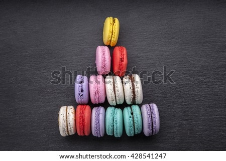 delicious French dessert macarons on a black background