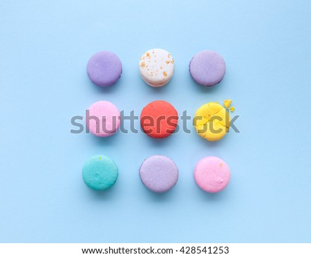 delicious French dessert macarons on a light blue background