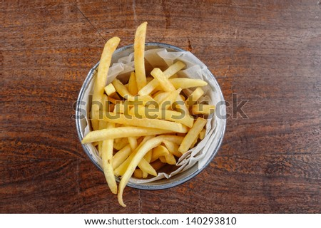 Delicious french fries closeup on the table - stock photo