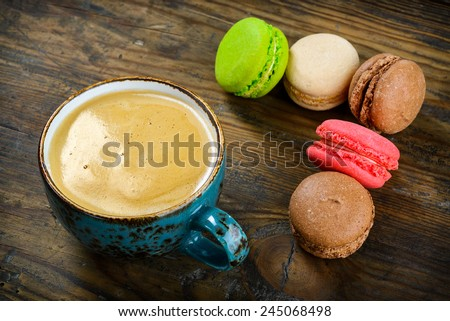 Delicious French macarons almond cookies served with a cup of black coffee - stock photo