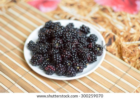 Delicious fresh blackberry on a white plate