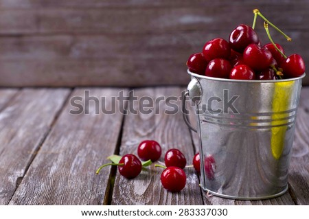 delicious fresh cherries on grey wooden table - stock photo
