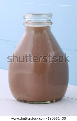 Delicious fresh chocolate milk, on vintage styling. - stock photo