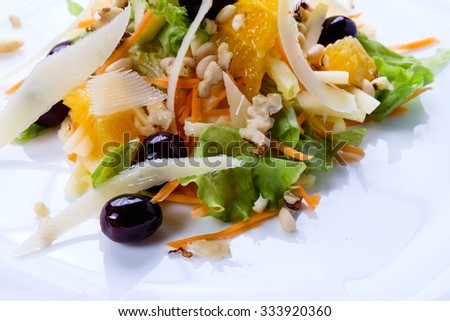 Delicious fresh dishes from the restaurant menu of fresh vegetables and products on a white dish. - stock photo
