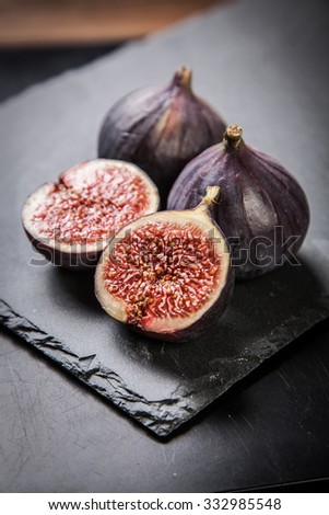Delicious fresh figs on a stone plate