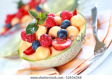 Delicious fresh fruits served in bowl as dessert - stock photo