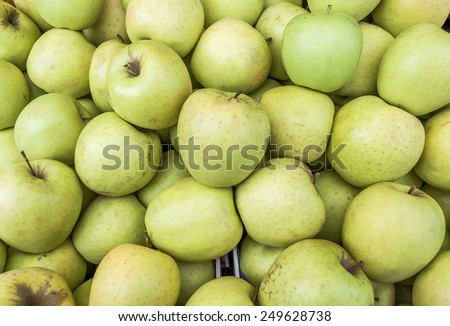 Delicious fresh green juicy apples in local fruit market