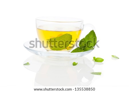 Delicious fresh herbal tea, made of fresh mint leaves isolated on white background. Healthy tea drinking concept.