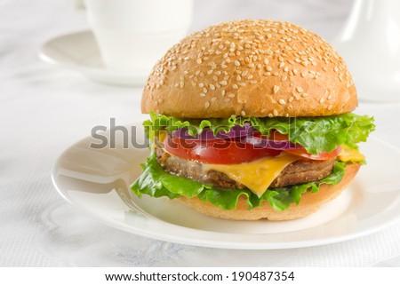 Delicious fresh homemade cheeseburger closeup. - stock photo