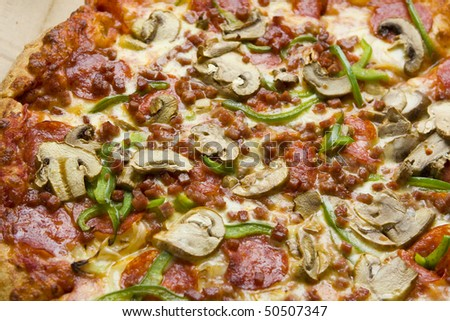 Delicious fresh homemade italian pizza with pepper, mushroom, pepperoni