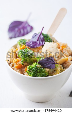 Delicious fresh meal with quinoa, vegetables and meat - stock photo