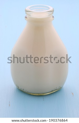 Delicious fresh  milk, on vintage styling. - stock photo
