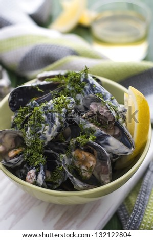 Delicious fresh mussels with beacon and cream - stock photo