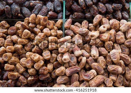 Delicious fresh organic dates in a market - stock photo