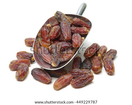 Delicious fresh organic dates on white background