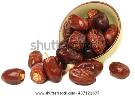 Delicious fresh organic dates over white background