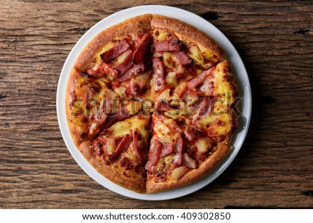 Delicious fresh pizza served on wooden table. view from top - stock photo