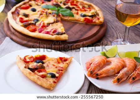 Delicious fresh pizza with seafood on wood table horizontal - stock photo