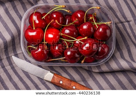 Delicious Fresh red organic Cherry, cherries in a plastic box