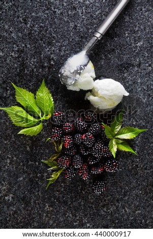 delicious fresh ripe Blackberry and Ice Cream. green leaves on the marble table