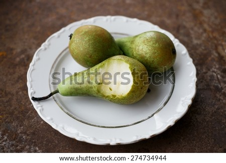 Delicious Fresh Ripe Pears On A White Plate Healthy Organic Food - stock photo