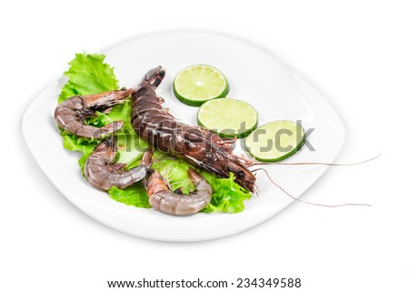 Delicious fresh shrimp with lemon on the white plate Isolated.  - stock photo