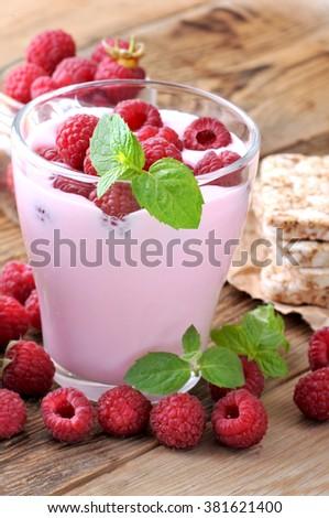 Delicious fresh yougurt with raspberry. - stock photo