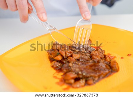 delicious freshly cooked dish of pork with sauce on the yelloow plate - stock photo