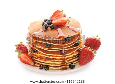 Delicious freshly prepared pancakes with strawberry and blueberries isolated on white - stock photo
