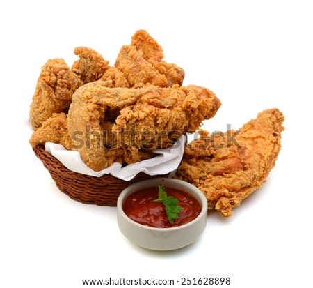 delicious fried chicken in basket with sauce on white background - stock photo