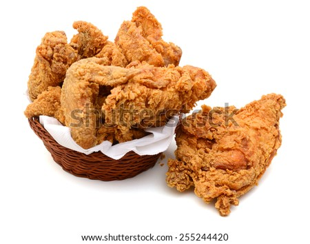 delicious fried chicken wings in bamboo basket isolated on white - stock photo