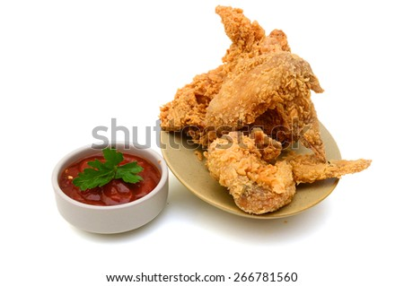 delicious fried chicken wings with bowl of sauce on plate isolated on white  - stock photo