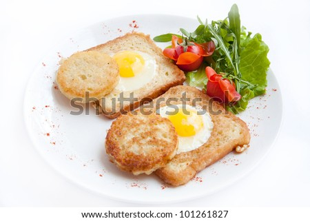 delicious fried eggs with toast, tomato, pancakes for breakfast