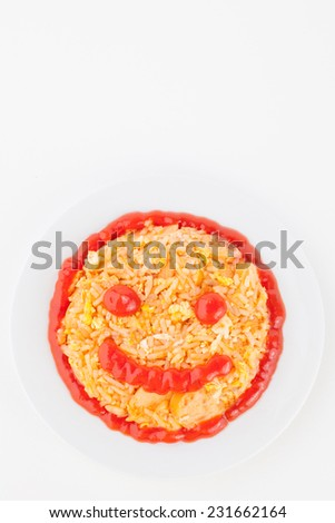 delicious fried rice with sausage for children on white paper background - stock photo
