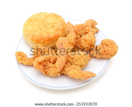 delicious fried shrimp and biscuit on plate on white background