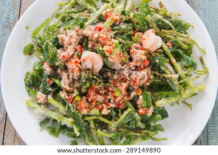 Delicious fried vegetable crisps and spicy sauce with shrimp  in a dish.Thai food .select focus.  - stock photo