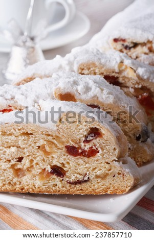 Delicious fruit cake German Stollen closeup on a plate. vertical