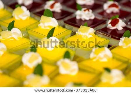 Delicious fruit desserts with fruit in small square bowls - stock photo