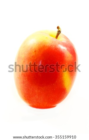 Delicious fruit red Apple photographed on a white background closeup - stock photo