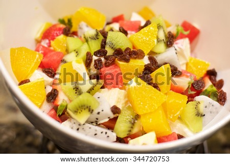 Delicious Fruit Salad with watermelon, oranges, kiwi and raisins